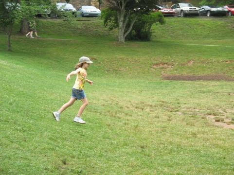 Libby running down a hill