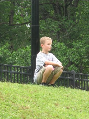 Harrison sitting at a tree