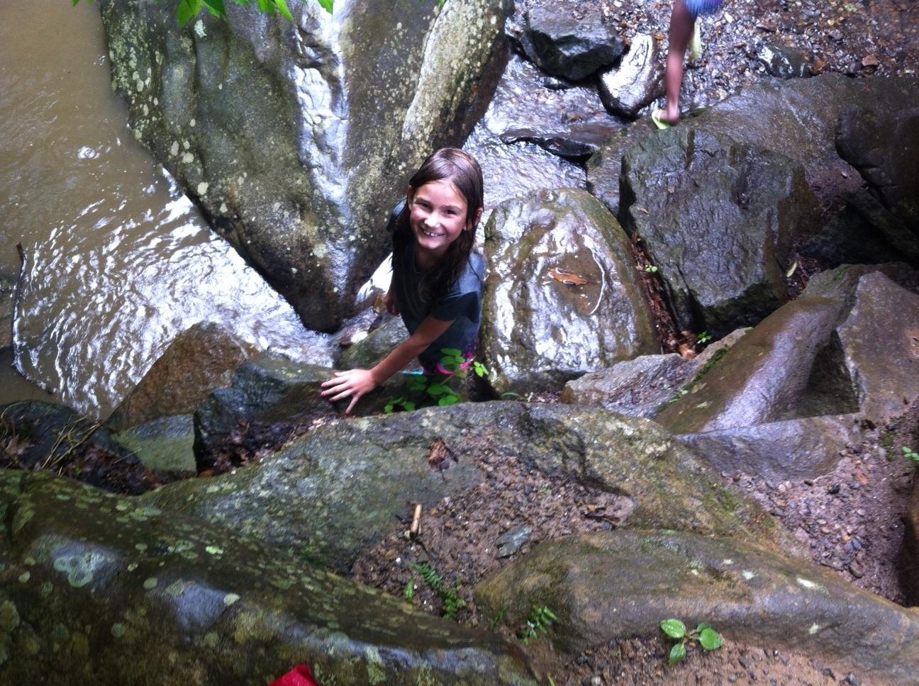 Jamie climbing down the rocks