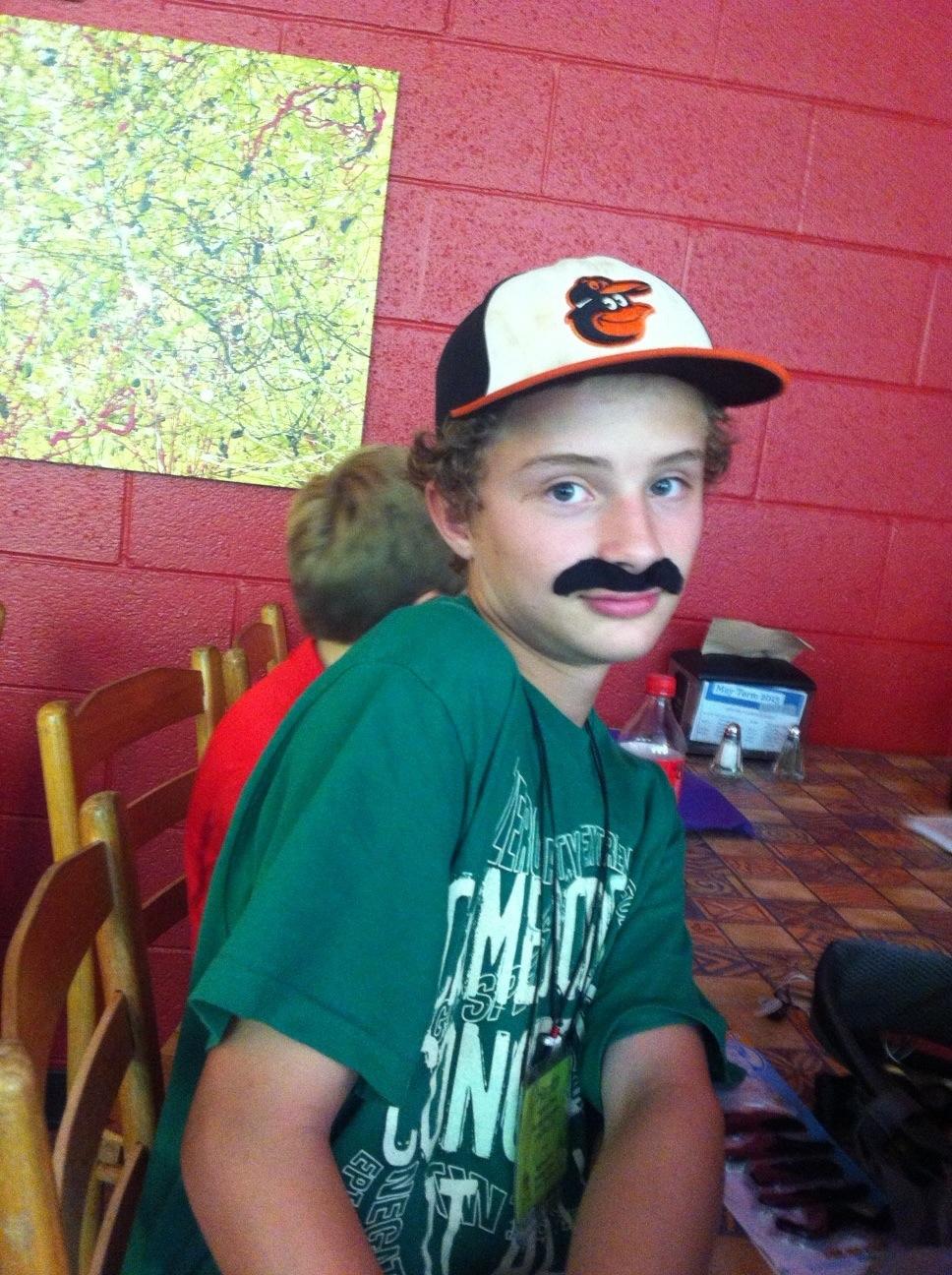 Harrison with black mustache sticker on