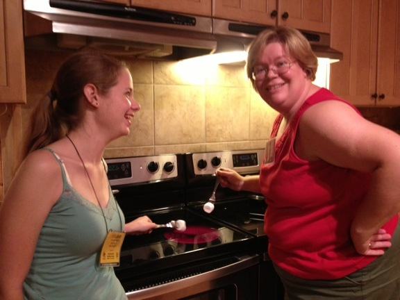 Mary and Elizabeth cooking marshmallows