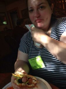Sarah Jane with hotdog in hamburger bun